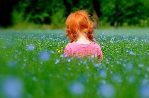 red head little girl in field